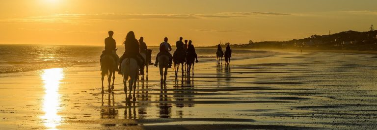 Mazagon-beach-at-sunset-horse-riding-route-Huelva-Atlantic-coast-Spain_413147650_1920x1280
