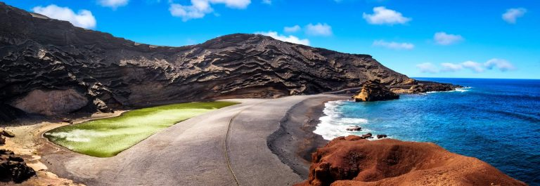View-into-a-volcanic-crater-with-its-green-lake-near-El-Golfo-Lanzarote-island_shutterstock_579556312_1920x1280