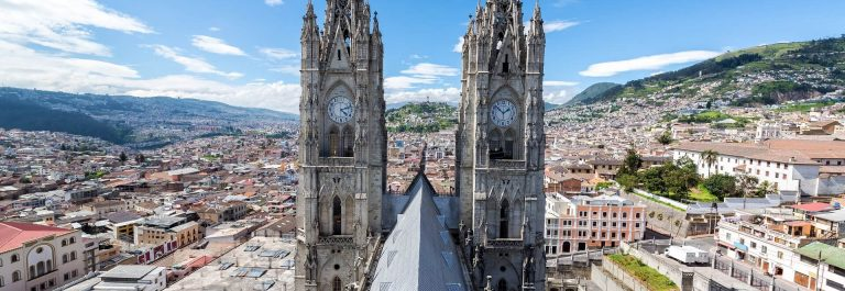 View-of-the-towers-of-the-Basilica-in-Quito-Ecuador-with-the-city-visible-in-the-background_shutterstock_245776240_1920x1280