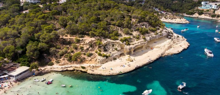 Aerial-view-view-over-the-Five-Fingers-Bay-of-Portals-Vells-Mallorca-Balearic-Islands-Spain-shutterstock_1273366360_1920x1280