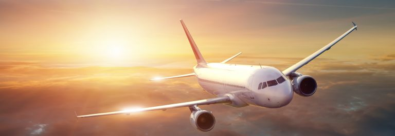 Airplane-in-the-sky-at-sunset_shutterstock_110793839