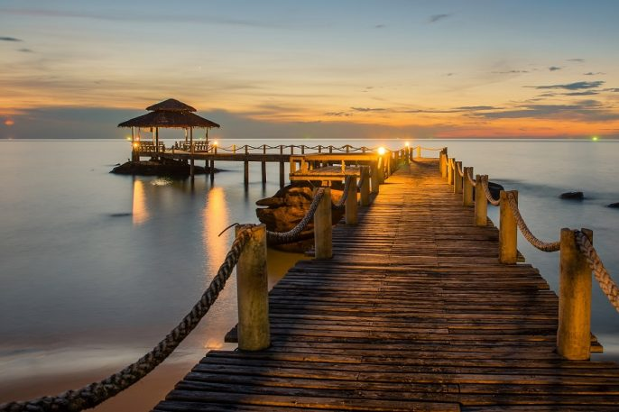 Landscape-of-Wooded-bridge-pier-between-sunset.-Summer-travel-in-Phuket-Thailand_shutterstock_242658232_900x600