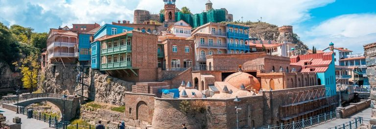 Old-sulfur-Baths-in-Abanotubani-district-with-wooden-carved-balconies-in-the-Old-Town-of-Tbilisi-Georgia._shutterstock_637332769_1920x1280