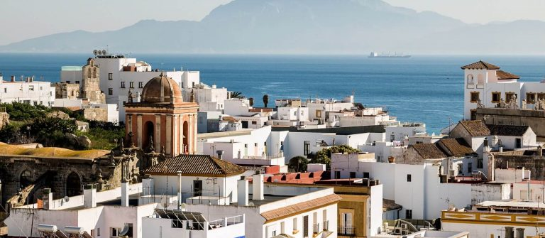 Village-of-Tarifa-located-in-the-Strait-of-Gibraltar.-In-the-background-you-can-see-Africa_554028832