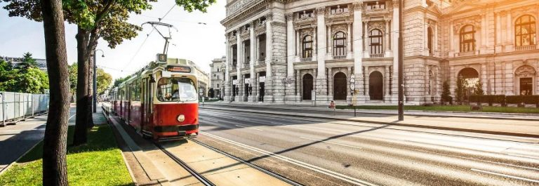 Wiener-Ringstrasse-with-tram-and-Burgtheater-at-sunrise-Vienna-iStock_000060702174_900x600