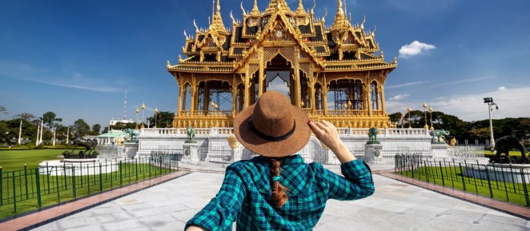 Woman-in-hat-and-green-checked-shirt-leading-man-to-the-Ananta-Samakhom-Throne-Hall-in-Thai-Royal-Dusit-Palace-Bangkok-Thailand_529323232