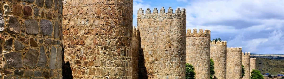 Mighty-medieval-wall-and-towers-surrounding-the-old-town-of-Avila-Spain_401426881_1920x1280