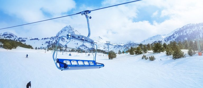 Ski-lift-seat-over-the-pistes-in-mountains-in-Grandvalira-Andorra_shutterstock_143413042_1920x1280