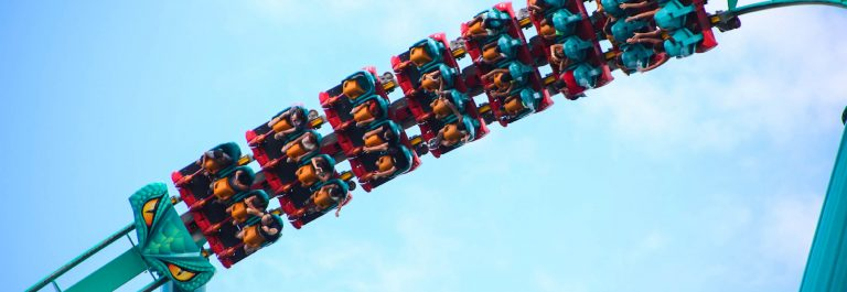 People-riding-a-rollercoaster-iStock_000044741246_Large-2