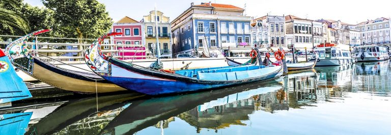 The-panorama-of-Aveiro-city-and-canal-with-boats-Portugal-shutterstock_123341143-2-1