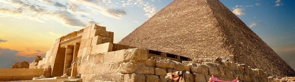 Camel-rests-near-ruins-of-entrance-to-pyramid_331234733-1
