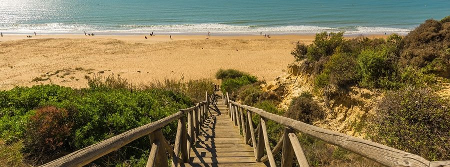 Wooden-runway-within-Mazagon-beach-Huelva-Spain_508246123_900x600